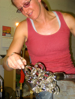 Kiara Pelissier blowing glass